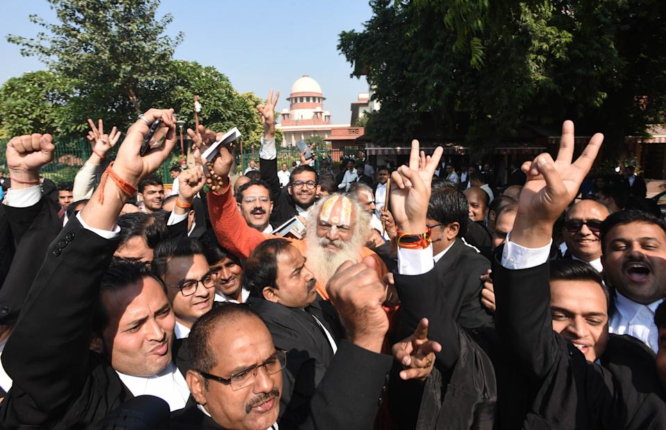 NEW DELHI, INDIA  NOVEMBER 9: Mahant Dharam Dass and lawyers celebrate after the Supreme Court verdict in the Ram Janmabhoomi Babri Masjid case, on November 9, 2019 in New Delhi, India.  The Supreme Court on Saturday cleared the way for a temple to be built at the disputed plot of land in Ayodhya where the Babri Masjid stood before its demolition, and which Hindus consider to be the birthplace of Lord Ram. Supreme Court orders that Central Govt within 3-4 months formulate scheme for setting up of trust and hand over the disputed site to it for construction of temple at the site and a suitable alternative plot of land measuring 5 acres at Ayodhya will be given to Sunni Wakf Board. (Photo by Sonu Mehta/Hindustan Times via Getty Images)