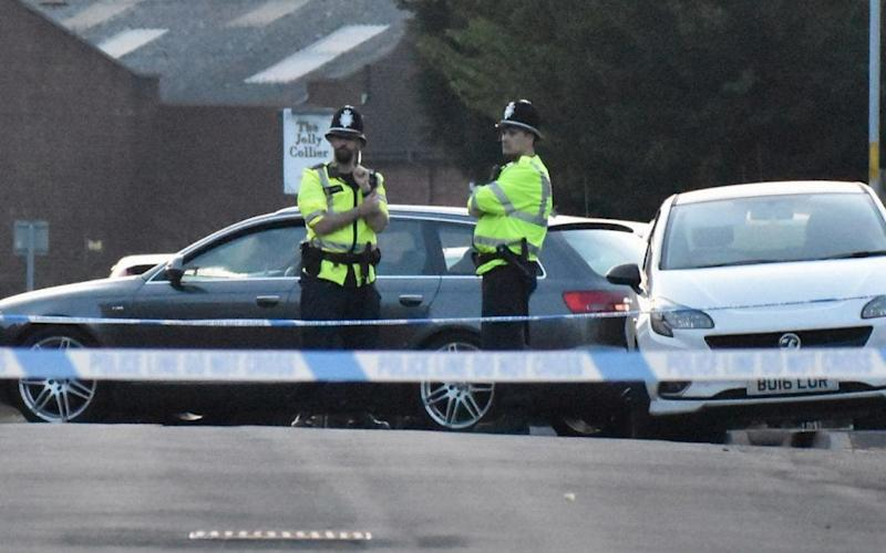 Police at the scene in Wolverhampton where a six-year-old boy was injured  - PA