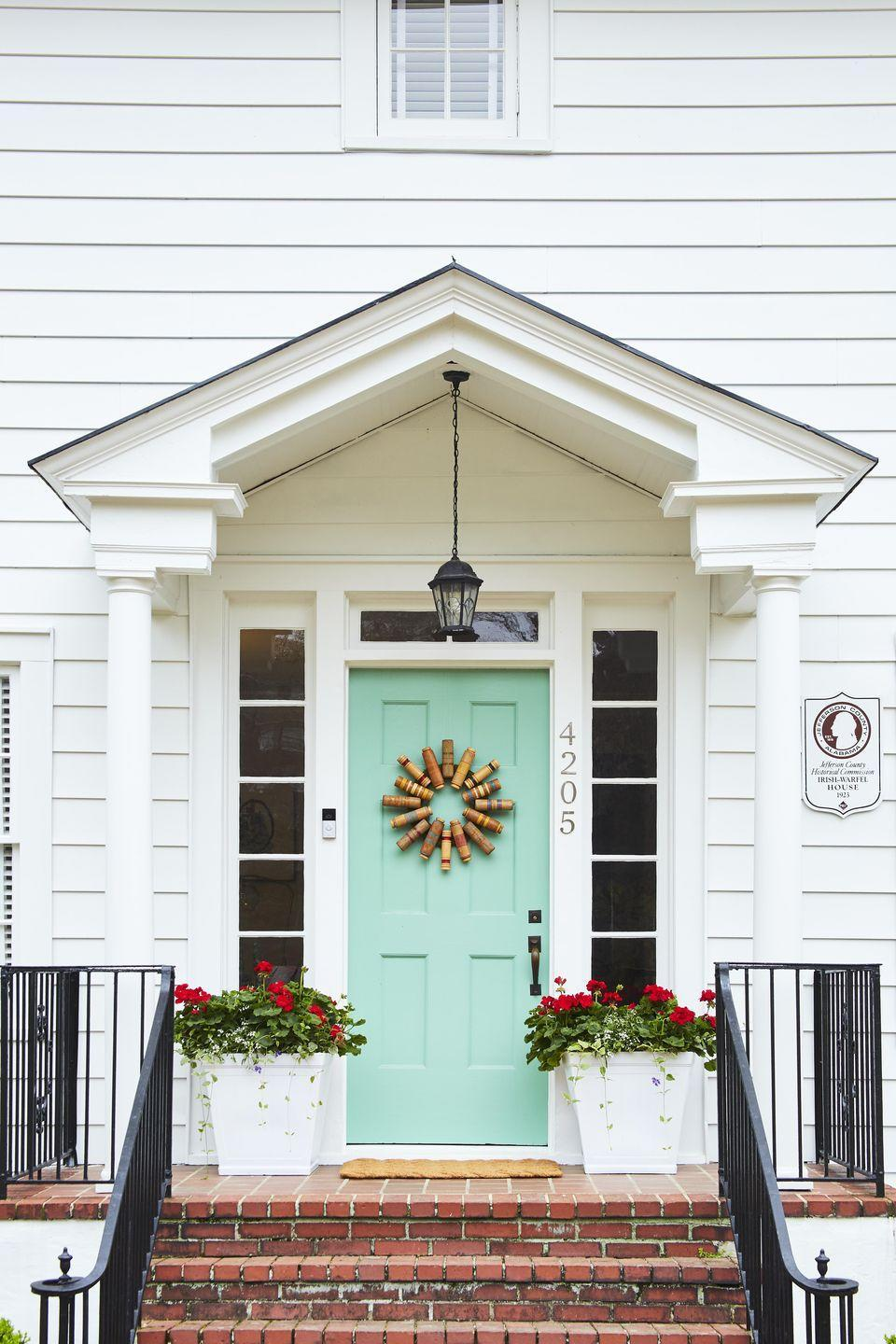 <p>Welcome guests with a spirited wreath made from the heads of croquet mallets. A brightly colored door (here Arsenic by Farrow & Ball) adds to the cheer.<strong><br><br>To make:</strong> Cover a 14-inch biodegradable craft ring with a peel-and-stick moss mat. Remove the handles from about 16 croquet mallets. Hot-glue heads to wreath, offsetting every other one slightly (reserve handles for another DIY). Carefully turn over wreath, and use a nail gun to permanently attach heads.</p>