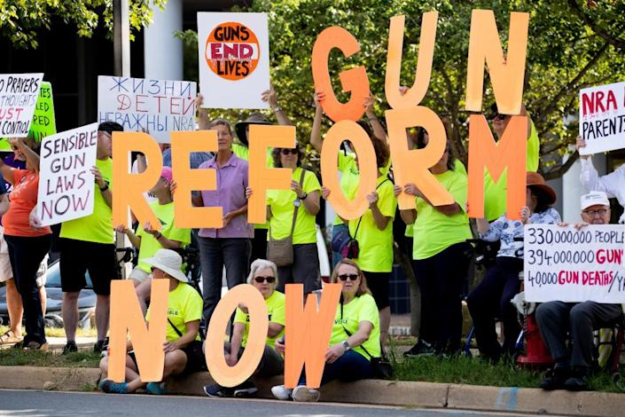 """<span class=""""element-image__caption"""">Supporters of gun control reform protest against the NRA at their headquarters in Fairfax, Virginia.</span> <span class=""""element-image__credit"""">Photograph: Michael Reynolds/EPA</span>"""