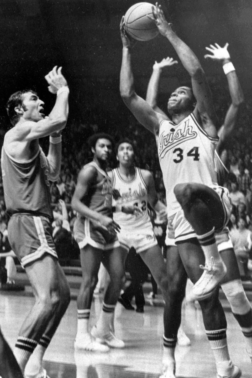 FILE - In this Jan. 23, 1971, file photo, Notre Dame's Austin Carr goes to the basket as UCLA's Steve Patterson, left, defends, during a college basketball game in South Bend, Ind. Carr had 46 points in an 89-82 victory. Carr played for Notre Dame in an era when prolific scorers dominated college basketball. It wasn't until Carr scored a still-standing NCAA Tournament-record 61 points against Ohio in the first round in 1970 that, in his mind, he started to separate himself. (AP Photo/Richard Horowitz, File)