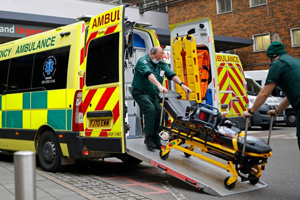 "Paramedics remove a gurney from the back of an ambulance parked outside Guy's Hospital in London on December 29, 2020, as a new strain of the coronavirus appears to be behind the recent upsurge in cases, heaping further pressure on the state-run National Health Service during its busiest winter period. - England is ""back in the eye"" of the coronavirus storm, health chiefs warned, with as many patients in hospital as during the initial peak in April. (Photo by Tolga Akmen / AFP) (Photo by TOLGA AKMEN/AFP via Getty Images)"