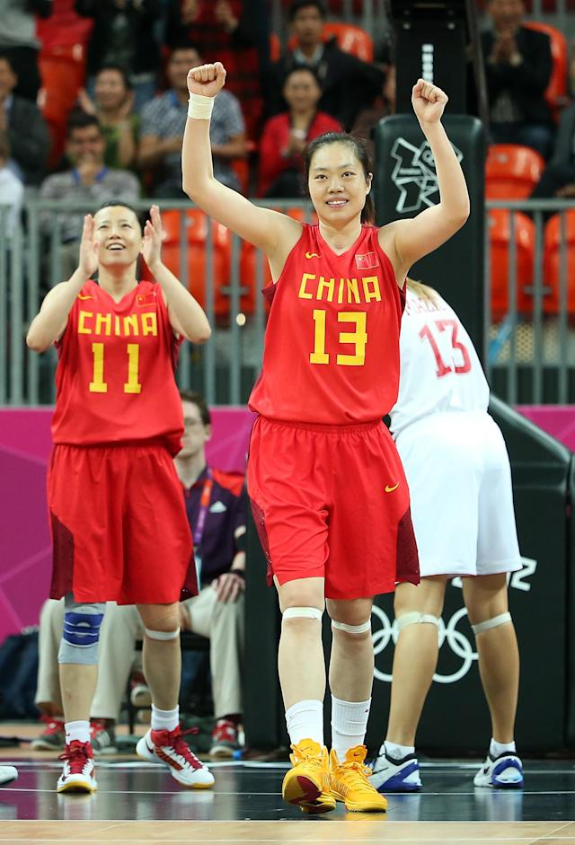 LONDON, ENGLAND - JULY 30: (R-L) Xiaoli Chen #13 and Zengyu Ma #11 of China celebrate after defeating Croatia in the Women's Preliminary Round match on Day 3 at Basketball Arena on July 30, 2012 in London, England. (Photo by Christian Petersen/Getty Images)