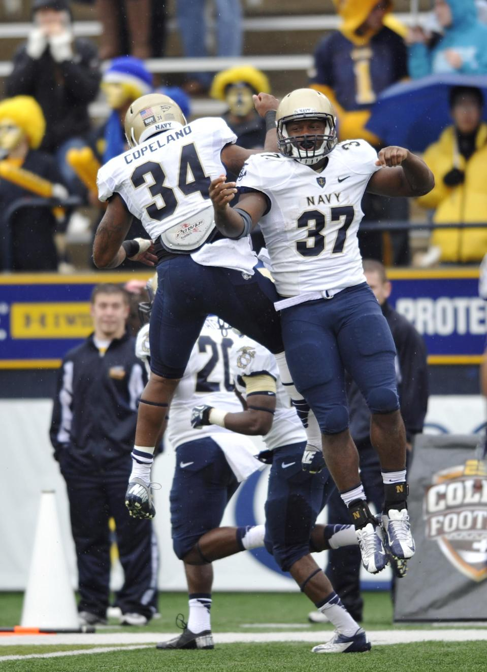 Navy fullback Chris Swain (37) celebrates his 2-yard touchdown run with fullback Noah Copeland during the first quarter of an NCAA college football game against Toledo in Toledo, Ohio, Saturday, Oct. 19, 2013. (AP Photo/David Richard)
