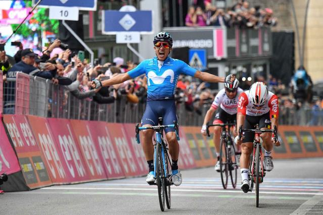 Richard Carapaz of Ecuador celebrates as he crosses the finish line to win the 4th stage of the Giro d'Italia, tour of Italy cycling race, from Orbetello to Frascati, Tuesday, May 14, 2019. Richard Carapaz of Ecuador sprinted to victory in the fourth stage of the Giro d'Italia on Tuesday, while Slovenian cyclist Primoz Roglic kept the overall lead after avoiding a crash toward the end of the route. (Alessandro Di Meo/ANSA via AP)
