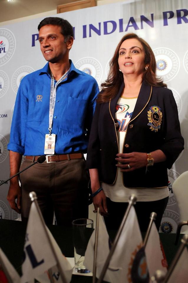 Mumbai Indians owner Nita Ambani with Rajasthan Royals` mentor Rahul Dravid during the two-day player auctions for the seventh edition of the Indian Premier League(IPL) in Bangalore on Feb.12, 2014. (Photo: IANS)