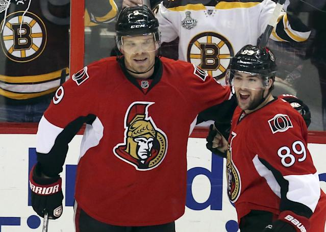 Ottawa Senators' Cory Conacher (89) celebrates his goal against the Boston Bruins with teammate Milan Michalek (9) during the first period of an NHL hockey game in Ottawa, Ontario on Saturday, Dec. 28, 2013. (AP Photo/The Canadian Press, Fred Chartrand)