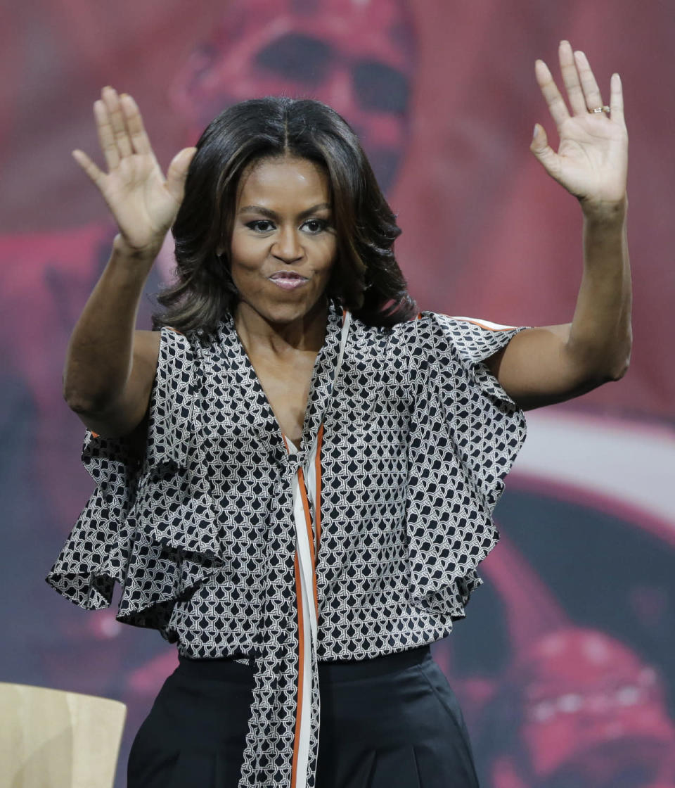 <p>This is what a first lady wears to hang with LeBron James. The duo teamed up to celebrate the importance of secondary education. The basketball player wore flat-rimmed hat and long-sleeved Nike tee while Obama went for a more dressy look in black trousers and a ruffle blouse. </p>