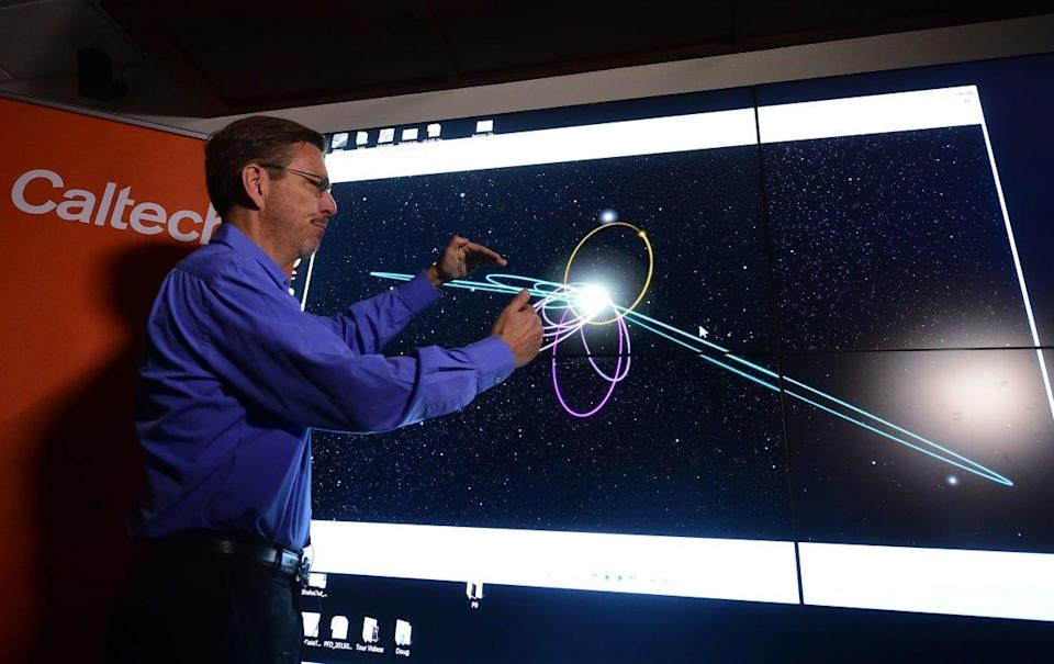 """<div class=""""inline-image__caption""""><p>Caltech astronomer Mike Brown briefs the media about a potential ninth planet.</p></div> <div class=""""inline-image__credit"""">AFP via Getty</div>"""