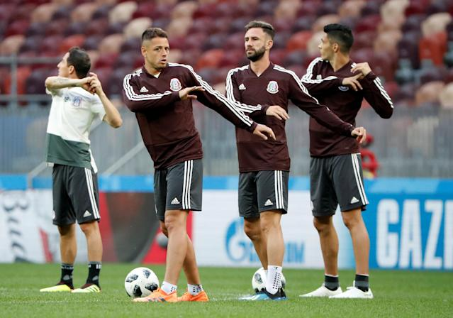 Soccer Football - World Cup - Mexico Training - Luzhniki Stadium, Moscow, Russia - June 16, 2018 Mexico's Javier Hernandez and Miguel Layun during training REUTERS/Grigory Dukor