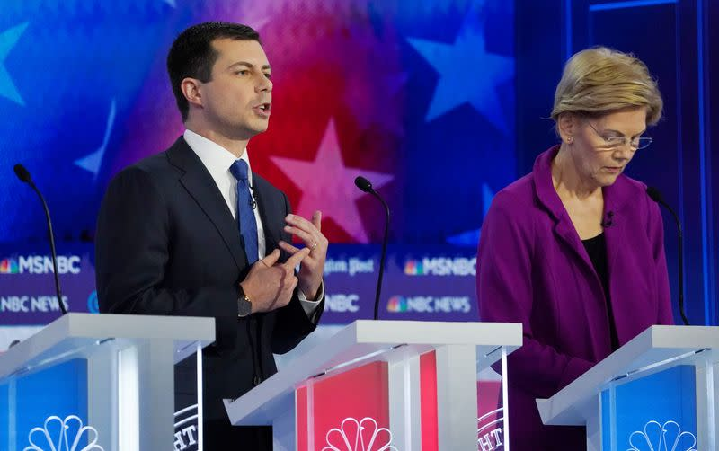 FILE PHOTO: Democratic presidential candidate and South Bend Mayor Pete Buttigieg speaks during a break the fifth 2020 campaign debate at the Tyler Perry Studios in Atlanta, Georgia