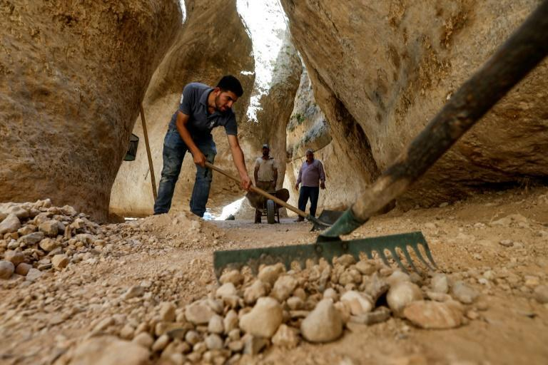 In the narrow pass at the foot of the canyon, men have been working in the summer heat to prepare the site for visitors