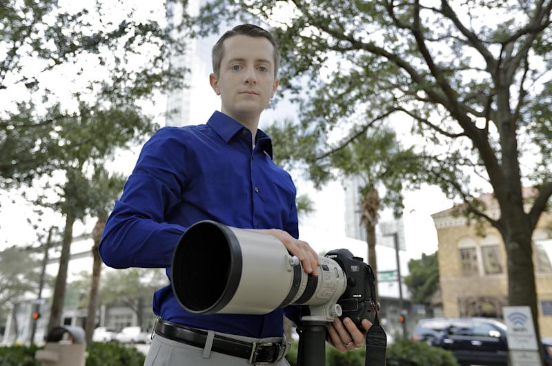"""In this photo taken Feb 9, 2017, Mike Schwarz, sole proprietor of Mike Schwarz Photography, poses for a photo in Tampa, Fla. Schwarz is a self-employed business owner who buys his own health insurance. The subsidized coverage """"Obamacare"""" offers provides him protection from life's unpredictable changes and freedom to pursue his vocation, he says. (AP Photo/Chris O'Meara)"""