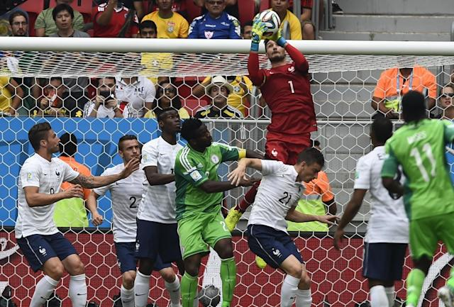 France's goalkeeper Hugo Lloris (top) saves the ball during their 2014 World Cup round of 16 game against Nigeria at the Brasilia national stadium in Brasilia June 30, 2014. REUTERS/Dylan Martinez (BRAZIL - Tags: SOCCER SPORT WORLD CUP)