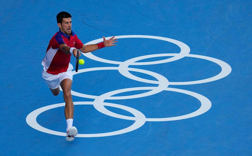 Novak Djokovic reaches for a shot in his loss Pablo Carreno Busta in a bronze medal match.