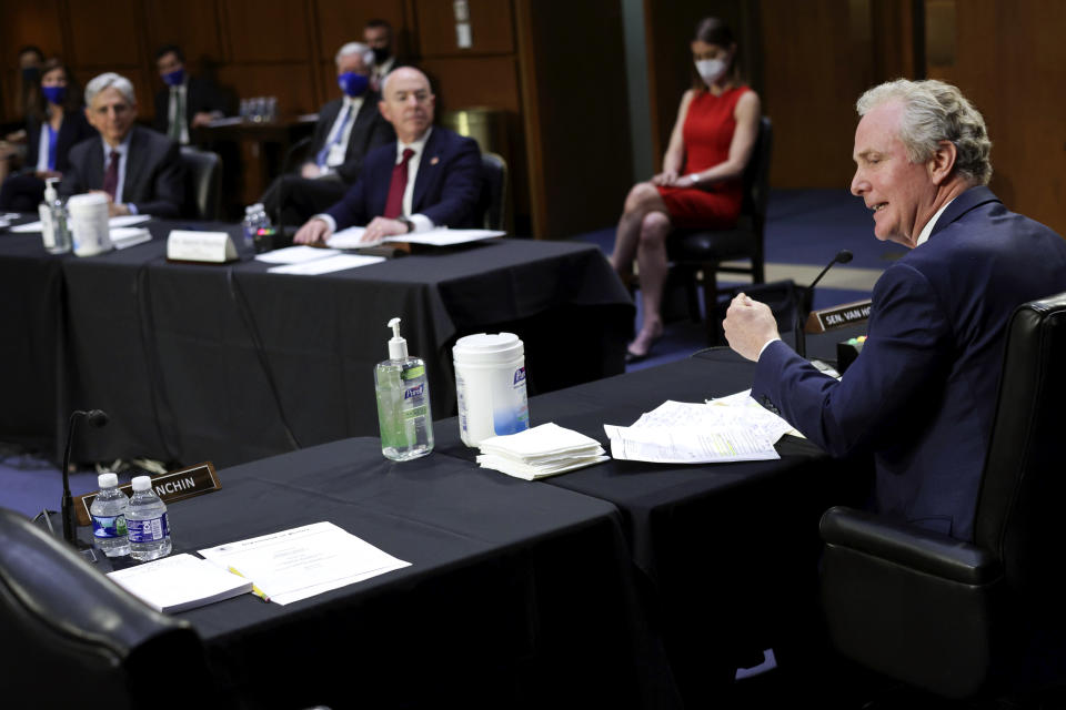 Sen. Chris Van Hollen, D-Md., as Attorney General Merrick Garland and Homeland Security Secretary Alejandro Mayorkas look on during a Senate Appropriations committee hearing to examine domestic extremism, Wednesday, May 12, 2021 on Capitol Hill in Washington. (Alex Wong/Pool via AP)