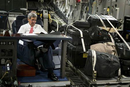 U.S. Secretary of State John Kerry looks over papers while flying from Jordan to Iraq September 10, 2014. REUTERS/Brendan Smialowski/Pool