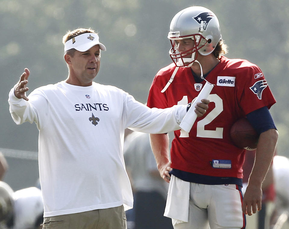 New Orleans Saints head coach Sean Payton chats with then-New England Patriots quarterback Tom Brady during a joint practice in 2010. (AP Photo/Winslow Townson)