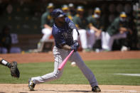 Tampa Bay Rays' Randy Arozarena hits a single against the Oakland Athletics during the third inning of a baseball game Saturday, May 8, 2021, in Oakland, Calif. (AP Photo/Tony Avelar)
