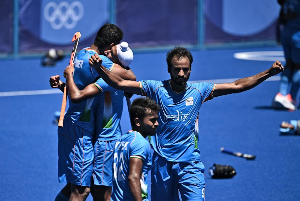Players of India celebrate after winning the men's bronze medal match