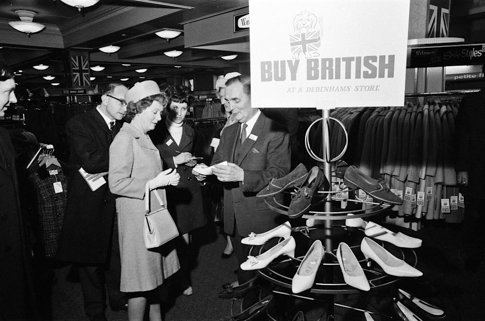 "The largest department store group in the country, Debenhams Ltd, who control 120 stores all over the country, started a ""Back Britain"" and ""Buy British"" campaign to help in the present financial crisis. Mary Wilson, the wife of the Prime Minister, opened the campaign at Swan and Edgar. She visited the shop from top to bottom, buying a pair of shoes in white leather with a corded silk bow. She was taken around by the Chairman of Debenhams Ltd, Mr John Bedford, 1st February 1968. (Photo by Mirrorpix via Getty Images)"