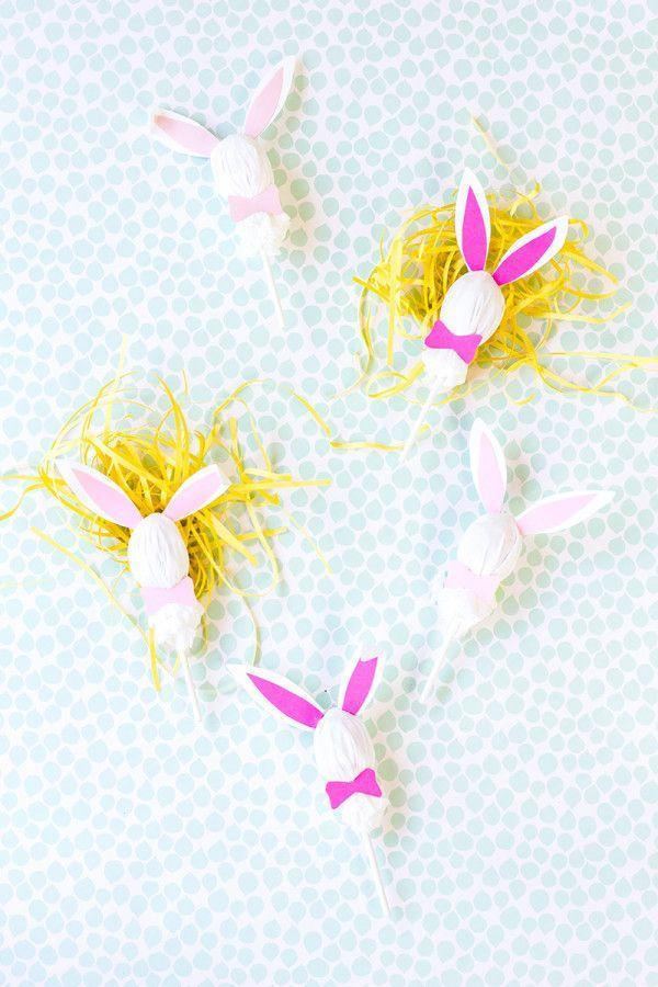 """<p>Consider using these adorable bunny lollipops — made with just some tissues, twine, paper, and glue — as place cards or as toppers on your Easter cake.</p><p><em><a href=""""http://studiodiy.com/2014/04/16/diy-easter-bunny-lollipops/"""" rel=""""nofollow noopener"""" target=""""_blank"""" data-ylk=""""slk:Get the tutorial at Studio DIY »"""" class=""""link rapid-noclick-resp"""">Get the tutorial at Studio DIY »</a></em> </p><p><a class=""""link rapid-noclick-resp"""" href=""""https://www.amazon.com/Darice-BT104-Bakers-Cotton-410-Feet/dp/B00AFDY6I4/?tag=syn-yahoo-20&ascsubtag=%5Bartid%7C10055.g.2217%5Bsrc%7Cyahoo-us"""" rel=""""nofollow noopener"""" target=""""_blank"""" data-ylk=""""slk:BUY PINK TWINE"""">BUY PINK TWINE</a><br> </p>"""