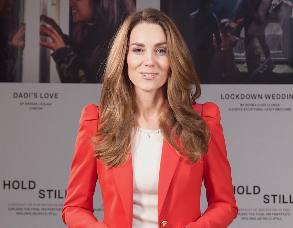 Kate Middleton in a red jacket with bronde hair