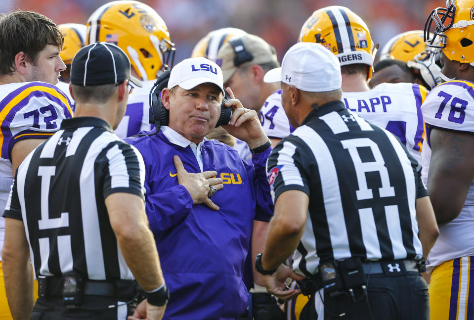 FILE - Then-LSU head coach Les Miles talks with referees during the first half of an NCAA college football game against Auburn in Auburn, Ala., in this Saturday, Sept. 24, 2016, file photo. Then-Athletic Director Joe Alleva's recommendation to former LSU President F. King Alexander is detailed in a newly released report into how the university handled sexual misconduct complaints. The exhaustive report released Friday, March 5, 201, by the Husch Blackwell law firm, offers a scathing view of the resources and attention LSU has dedicated to such complaints and has resulted in the suspensions of two senior officials in the athletic department. (AP Photo/Butch Dill)