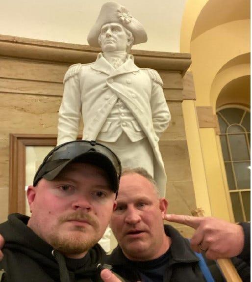 Jacob Fracker and Thomas Robertson, two off-duty police officers with the city of Rocky Mount, Virginia, are pictured inside the U.S. Capitol during the deadly Jan. 6 riot, in this photo released by the U.S. Department of Justice.
