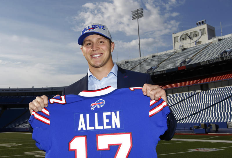 Buffalo Bills first-round pick Josh Allen poses with his jersey after the draft. (AP)