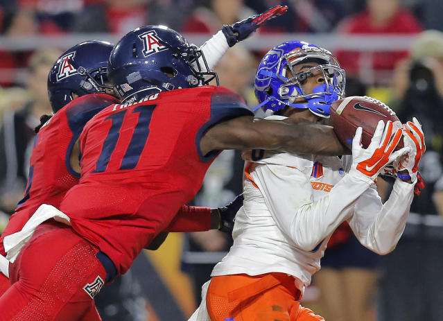 Boise State wide receiver Chaz Anderson (6) has a pass broken up by Arizona safety William Parks (11) during the second half of the Fiesta Bowl NCAA college football game, Wednesday, Dec. 31, 2014, in Glendale, Ariz. (AP Photo/Rick Scuteri)