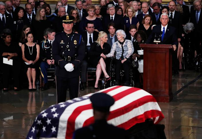 """<span class=""""s1"""">John McCain's daughter Meghan holds the hand of his mother, Roberta, as Vice President Mike Pence, right, speaks during ceremonies at the Capitol rotunda on Friday. (Photo: Eric Thayer/Reuters)</span>"""