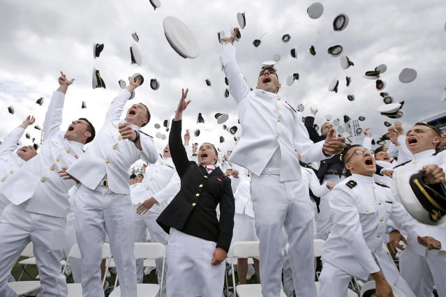 <p>U.S. Naval Academy graduates throw their hats into the air in celebration at the end of the academy's graduation and commissioning ceremony in Annapolis, Md., Friday, May 26, 2017. (Photo: Patrick Semansky/AP) </p>