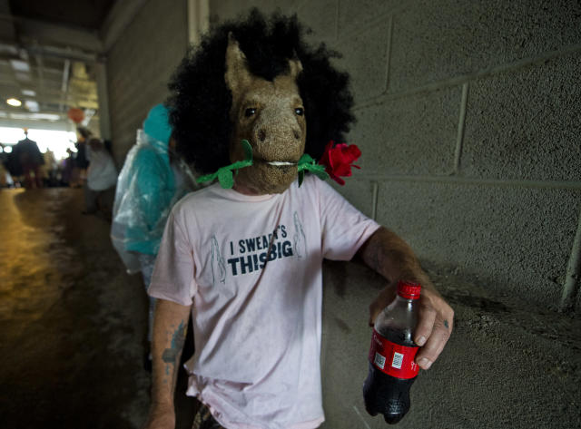 <p>A man wears a horse mask with a rose on Kentucky Derby Day at Churchill Downs on May 5, 2018 in Louisville, Ky. (Photo: Scott Serio/Eclipse Sportswire/Getty Images) </p>