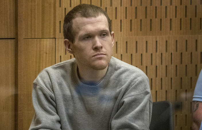 Twenty-nine-year-old Australian Brenton Harrison Tarrant sits in the dock at the Christchurch High Court for sentencing after pleading guilty to 51 counts of murder, 40 counts of attempted murder and one count of terrorism in Christchurch, New Zealand, Monday, Aug. 24, 2020. More than 60 survivors and family members will confront the New Zealand mosque gunman this week when he appears in court to be sentenced for his crimes in the worst atrocity in the nation's modern history. (John Kirk-Anderson/Pool Photo via AP)