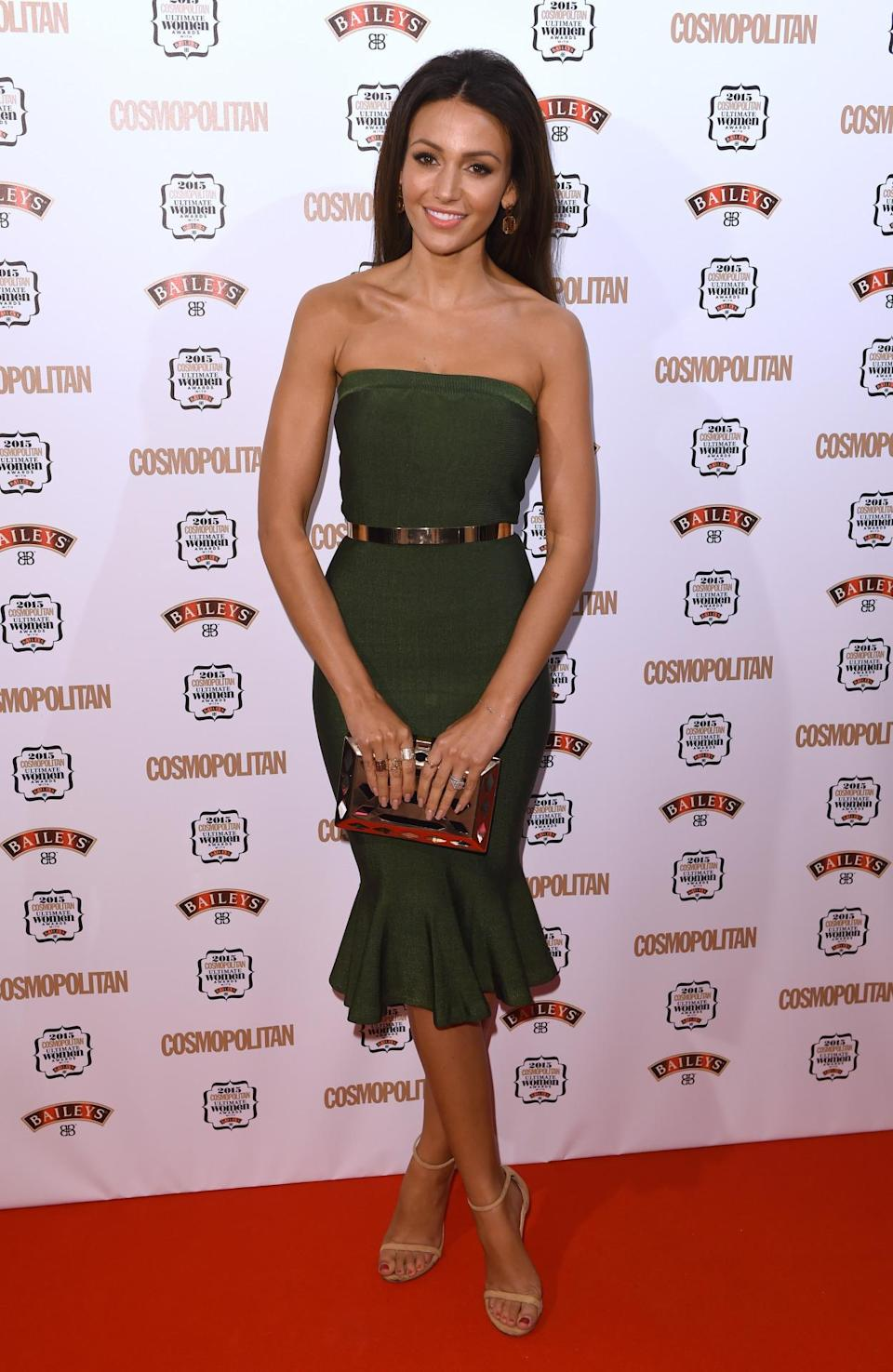 Michelle Keegan dressed her petite frame in an olive green strapless dress, featuring a fishtail skirt. [Photo: Rex]