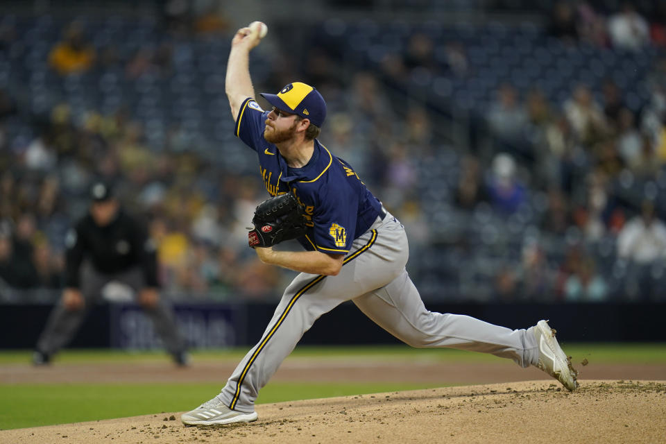 Milwaukee Brewers starting pitcher Brandon Woodruff works against a San Diego Padres batter during the first inning of a baseball game Monday, April 19, 2021, in San Diego. (AP Photo/Gregory Bull)