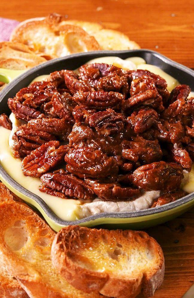 """<p>The caramelized topping is EVERYTHING. </p><p>Get the recipe from <a href=""""https://www.delish.com/holiday-recipes/thanksgiving/a24851390/pecan-pie-brie-recipe/"""" rel=""""nofollow noopener"""" target=""""_blank"""" data-ylk=""""slk:Delish"""" class=""""link rapid-noclick-resp"""">Delish</a>. </p>"""