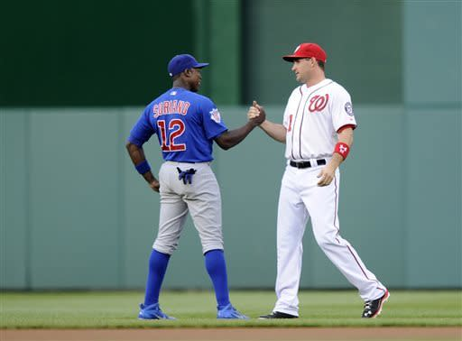 Washington Nationals' Ryan Zimmerman, right, greets Chicago Cubs' Alfonso Soriano (12) before a baseball game, Friday, May 10, 2013, in Washington. (AP Photo/Nick Wass)