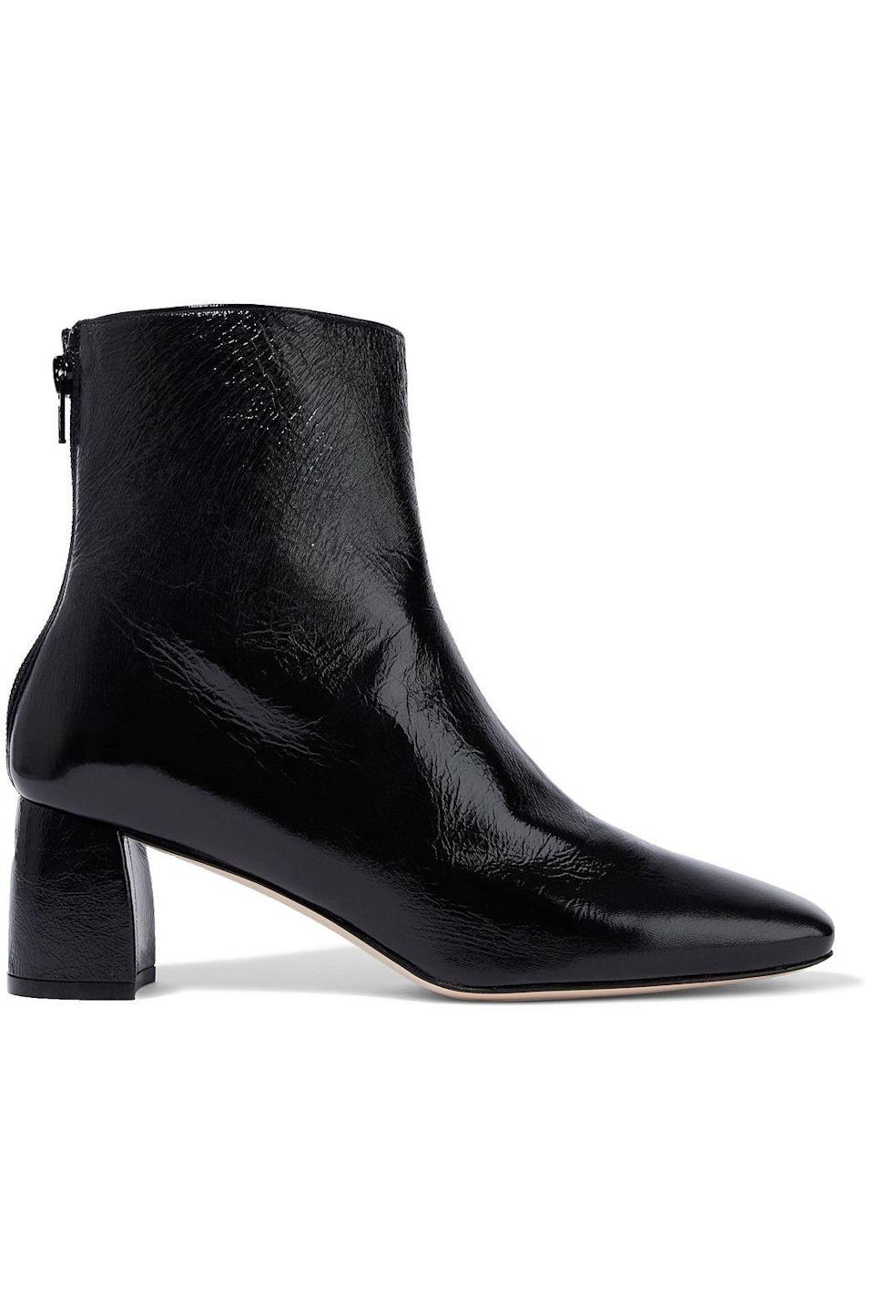 """<p><strong>Stuart Weitzman</strong></p><p>theoutnet.com</p><p><strong>$165.00</strong></p><p><a href=""""https://go.redirectingat.com?id=74968X1596630&url=https%3A%2F%2Fwww.theoutnet.com%2Fen-us%2Fshop%2Fproduct%2Fstuart-weitzman%2Fboots%2Fmid-heel-boots%2Fcrinkled-patent-leather-ankle-boots%2F7600457660315872&sref=https%3A%2F%2Fwww.marieclaire.com%2Ffashion%2Fg33594594%2Fthe-outnet-summer-sale-2020%2F"""" rel=""""nofollow noopener"""" target=""""_blank"""" data-ylk=""""slk:SHOP IT"""" class=""""link rapid-noclick-resp"""">SHOP IT</a></p><p>You're <em>always</em> in need of a classic pair of black ankle boots and this designer find for under $200 is basically a steal.</p>"""