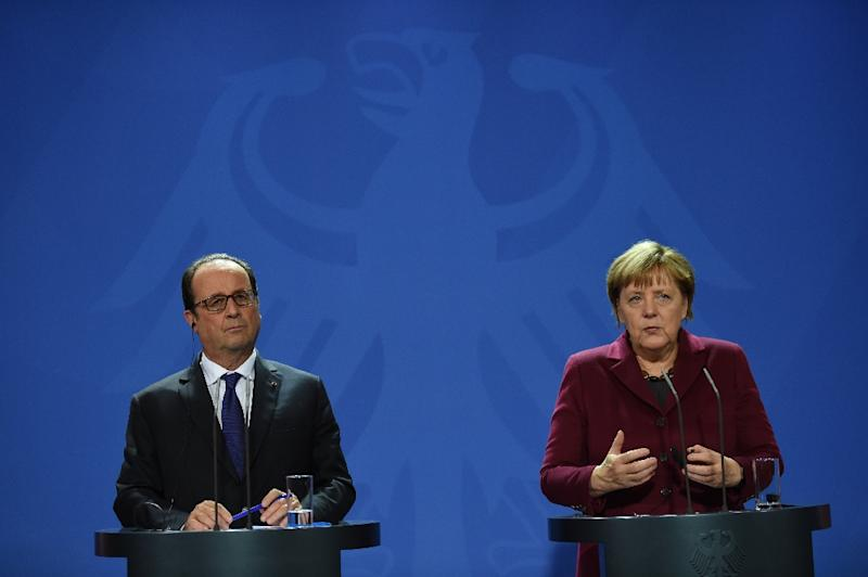 German chancellor Angela Merkel and French President Francois Hollande attend a press conference at the chancellery in Berlin, on October 19, 2016