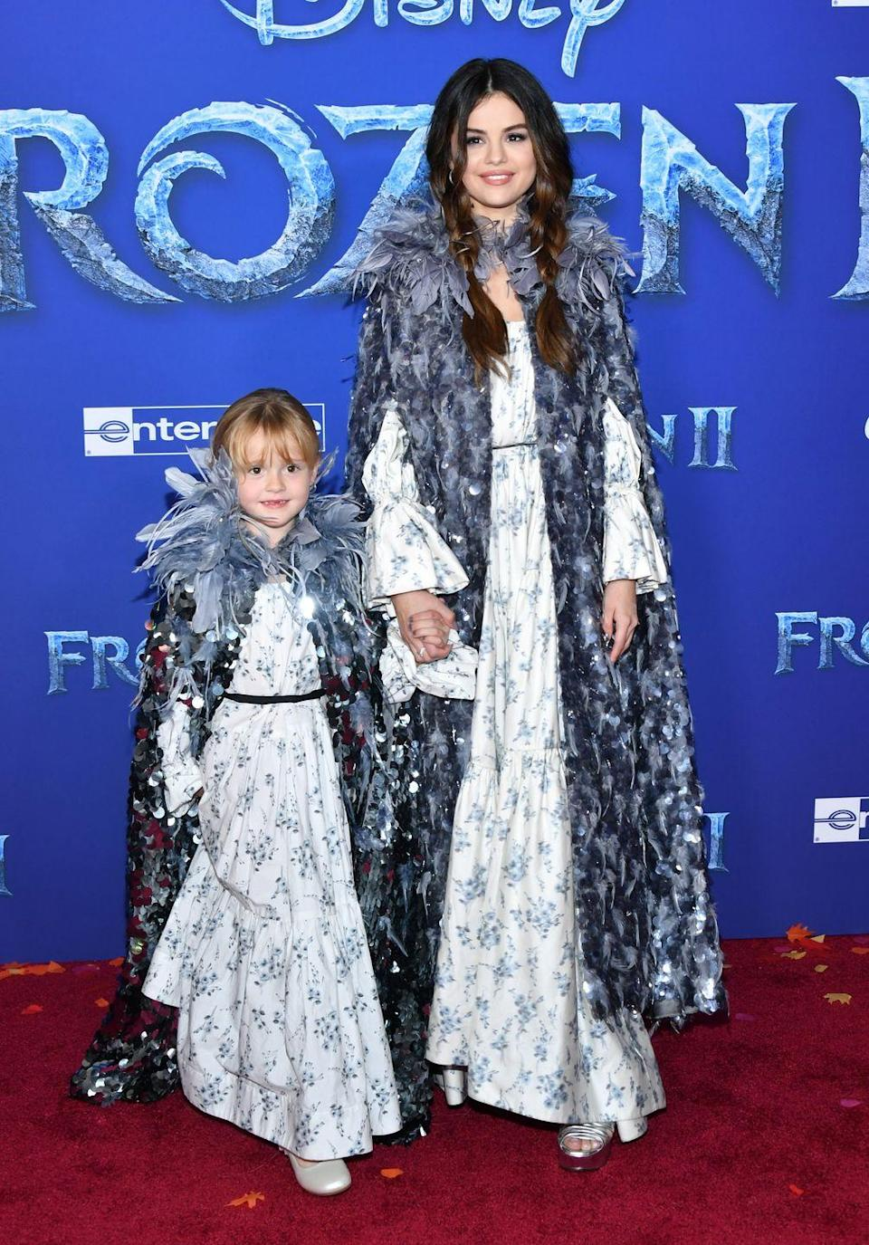 "<p>Matching in Marc Jacobs with her younger sister, Gracie Teefey, for the <a href=""https://www.elle.com/culture/celebrities/a29736487/selena-gomez-sister-matching-outfits-frozen-premiere/"" rel=""nofollow noopener"" target=""_blank"" data-ylk=""slk:premiere of Frozen 2."" class=""link rapid-noclick-resp"">premiere of <em>Frozen 2</em>.</a></p>"