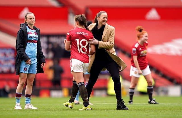 Manchester United manager Casey Stoney celebrates after the match