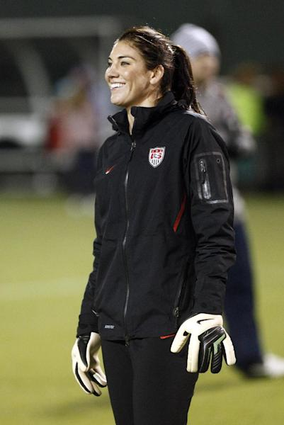 U.S. Women's National soccer team goalie Hope Solo smiles during practice in Portland, Ore., Tuesday, Nov. 27, 2012. The U.S. Team will play Ireland Wednesday in an exhibition game.(AP Photo/Don Ryan)