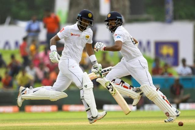 Sri Lanka captain Dimuth Karunaratne (L) and Lahiru Thirimanne set a record opening stand of 133 runs in the first Test against New Zealand (AFP Photo/ISHARA S. KODIKARA)