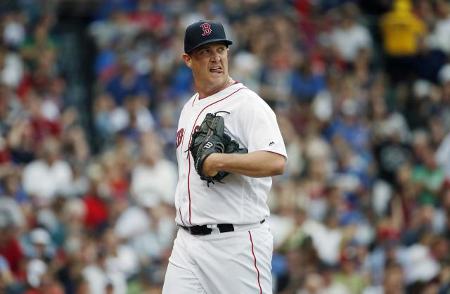 Red Sox pitcher Steven Wright was spotted Tuesday riding the subway to Fenway Park. (AP)