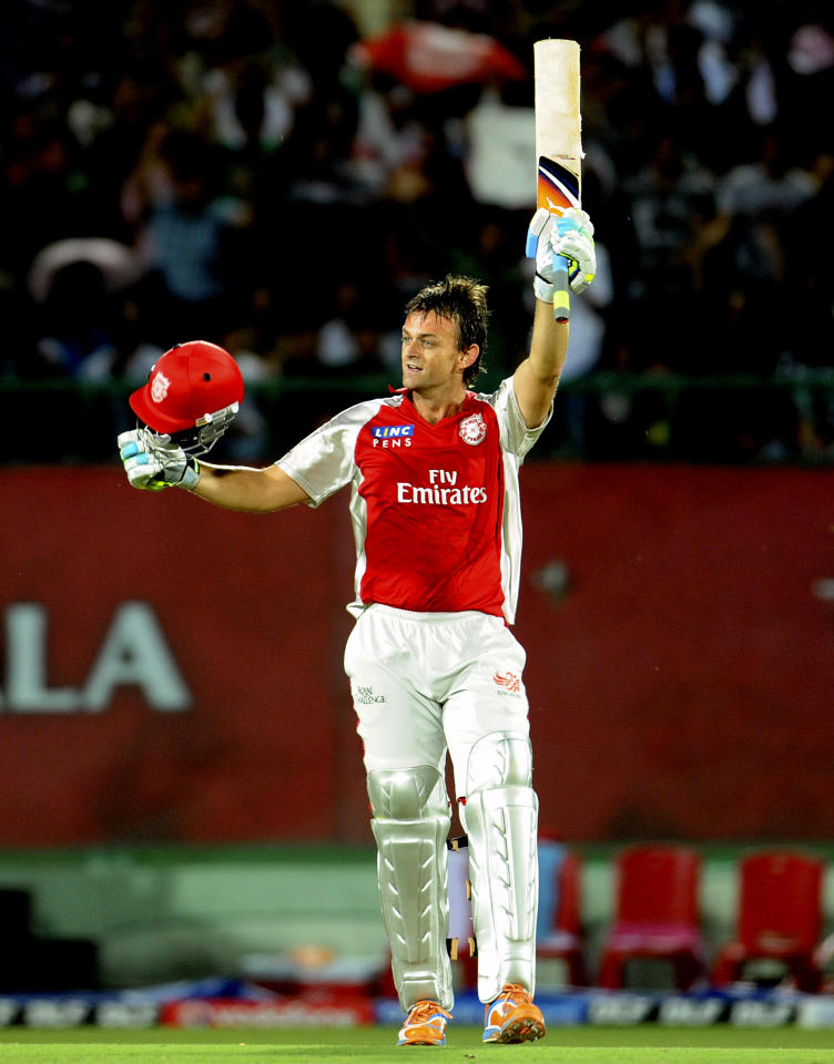 RESTRICTED TO EDITORIAL USEMOBILE USE WITH IN NEWS PACKAGE Kings XI Punjab captain Adam Gilchrist waves his bat after his century (100 run) during the IPL Twenty20 cricket match between Royal Challengers Bangalore and Kings XI Punjab at The Himachal Pradesh Cricket Association stadiun in Dharamsala on May 17, 2011.    AFP PHOTO/RAVEENDRAN (Photo credit should read RAVEENDRAN/AFP/Getty Images)