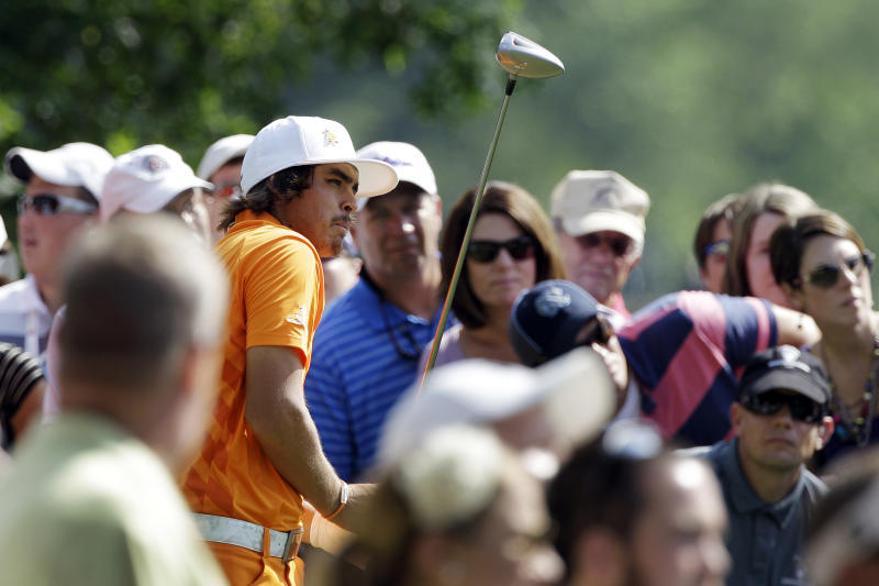 Rickie Fowler watches his tee shot on the 15th hole during the final round of the Wells Fargo Championship golf tournament at Quail Hollow Club in Charlotte, N.C., Sunday, May 6, 2012. Fowler won the tournament on the first playoff hole. (AP Photo/Chuck Burton)