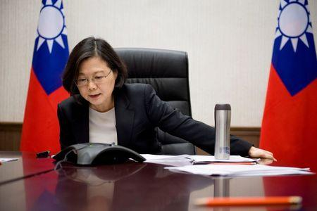 Taiwan's President Tsai Ing-wen speaks on the phone with U.S. president-elect Donald Trump at her office in Taipei
