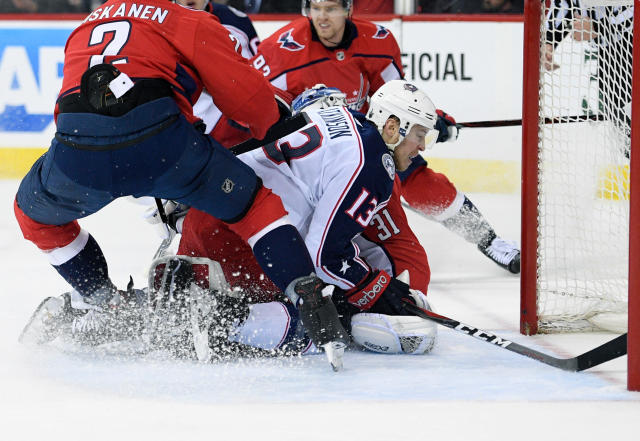 Columbus Blue Jackets right wing Cam Atkinson (13) collides into Washington Capitals goaltender Philipp Grubauer (31), of Germany, during the first period in Game 2 of an NHL first-round hockey playoff series, Sunday, April 15, 2018, in Washington. Also seen is Capitals defenseman Matt Niskanen (2). (AP Photo/Nick Wass)